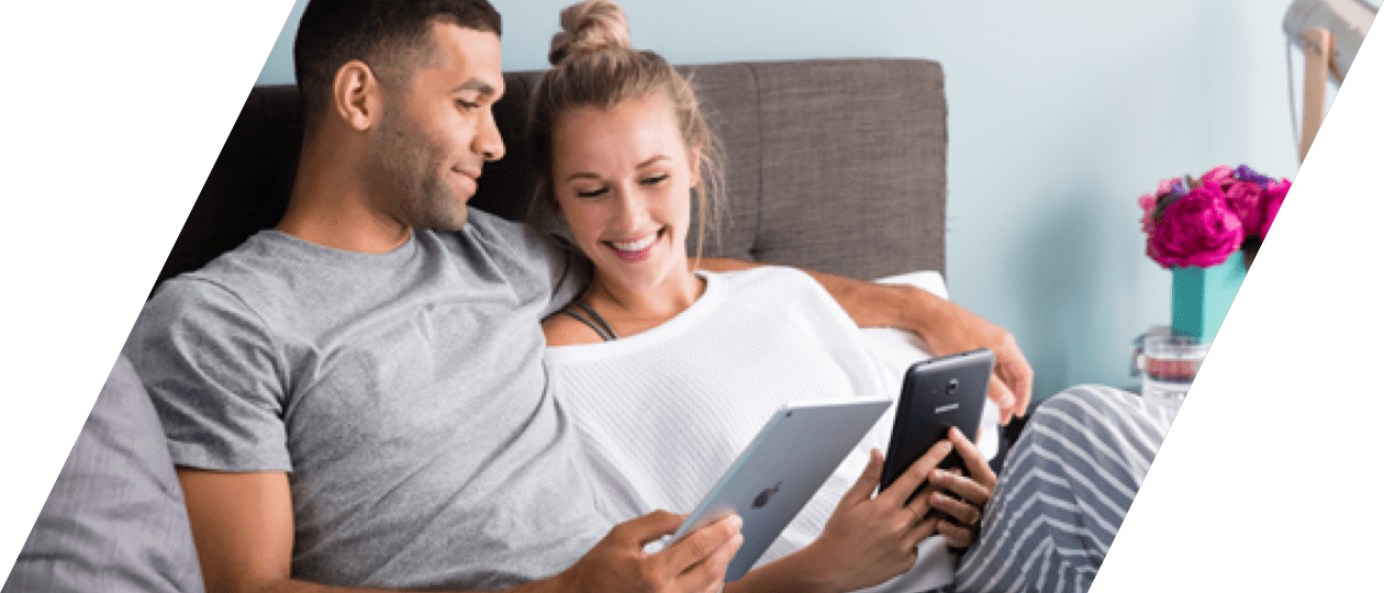 Couple using Scribd on tablet